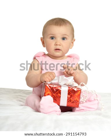 Portrait of Cute baby girl sitting  with gift - stock photo