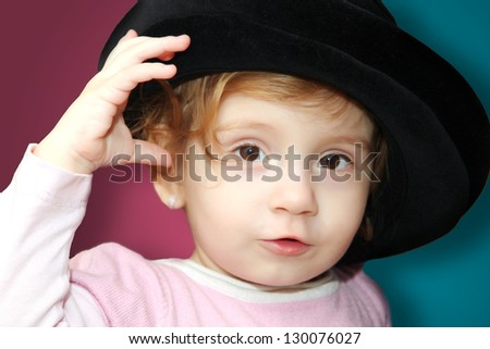 Portrait of cute baby girl with a hat - stock photo