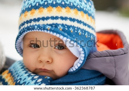 Portrait of cute baby in winter.                            - stock photo