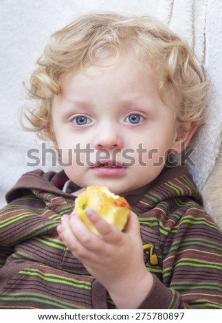 Portrait of Cute Blond Boy  with apple - stock photo