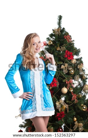 Portrait of cute blonde dressed as Snow Maiden - stock photo