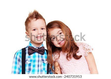 Portrait of cute boy and girl - stock photo