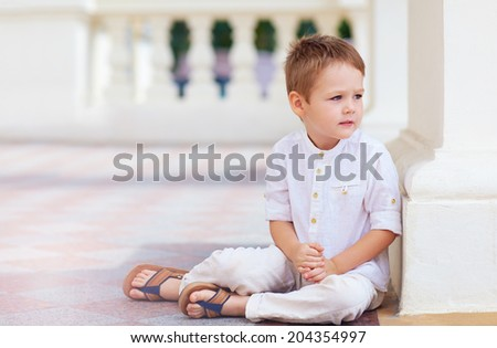portrait of cute boy in bright clothes - stock photo