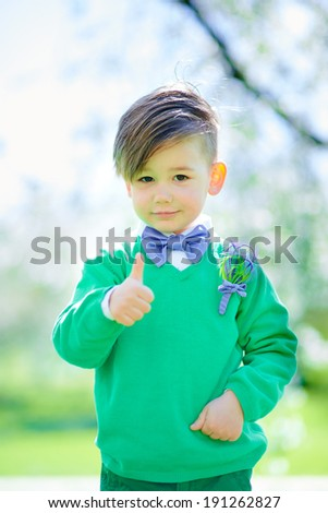 portrait of cute boy showing thumbs up. - stock photo