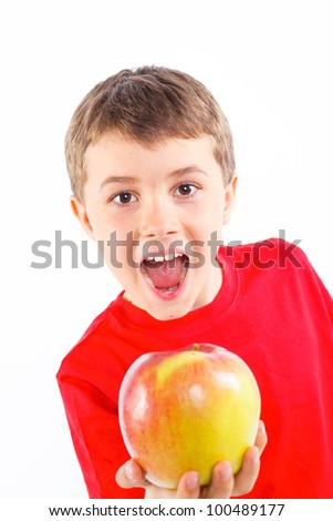 Portrait of cute boy with apple. Isolated on white background. - stock photo