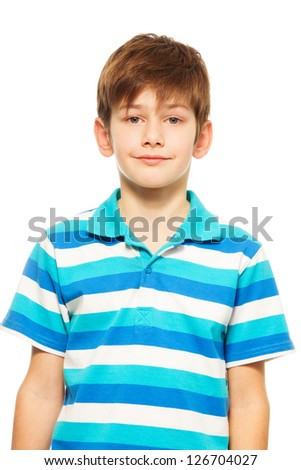 Portrait of cute Caucasian boy smiling and looking front - stock photo