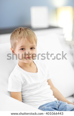 Portrait of cute cheerful boy - stock photo