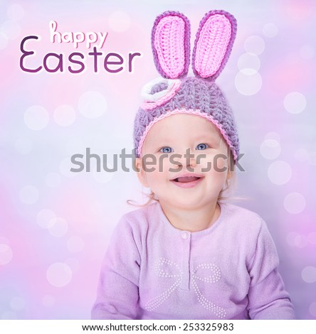 Portrait of cute cheerful Easter bunny, little baby girl wearing pink rabbit ears isolated on blur background, happy spring holiday concept - stock photo