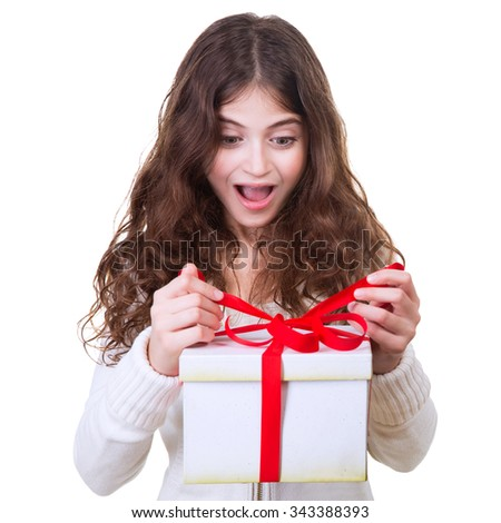 Portrait of cute cheerful teen girl receiving gift, excited facial expression, isolated on white background, celebrating Christmas holidays - stock photo
