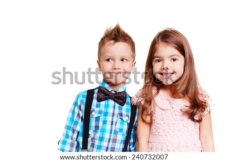 Portrait of cute children looking at camera - stock photo