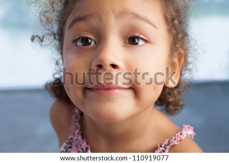 Portrait of cute curly little girl - stock photo