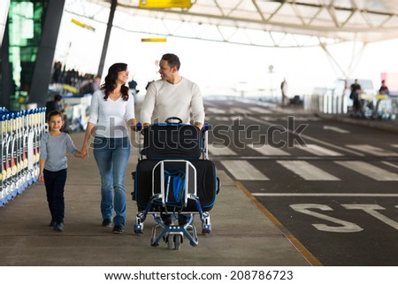 portrait of cute family travelling - stock photo