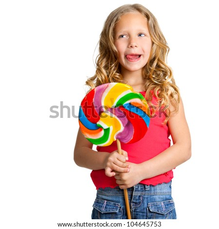 Portrait of cute girl holding huge colorful candy.Isolated on white. - stock photo