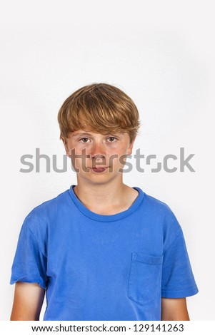 portrait of cute handsome boy in studio isolated on white - stock photo