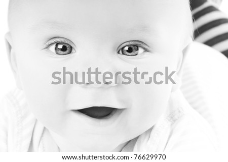 Portrait of cute happy little smiling baby in studio, black&white style - stock photo