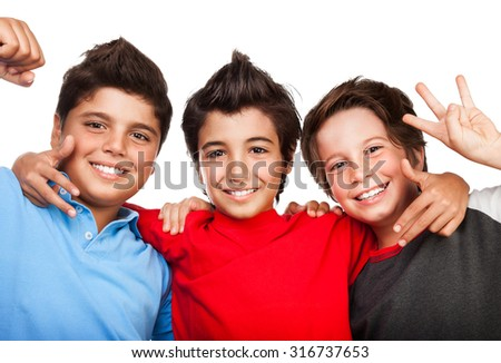 Portrait of cute happy three boys isolated on white background, cheerful teenagers, best friends hugging in the studio - stock photo