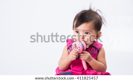 portrait of cute indian baby girl, asian baby girl indian girl child closeup over white background, indian baby girl front profile, white background - stock photo