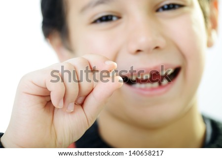 Portrait of cute kid losing his first tooth (Note: Selective focus) - stock photo