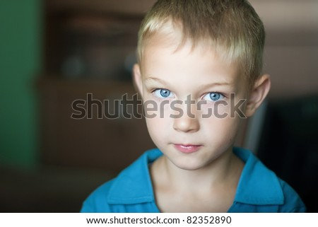 portrait of cute kid with blue eyes - stock photo