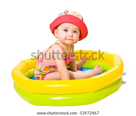Portrait of cute little baby girl in the swimming pool - stock photo