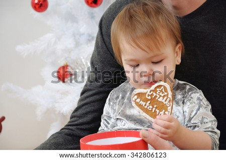 portrait of cute little baby girl with her father near Christmas tree, happy holiday concept, happy family - stock photo