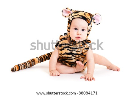 Portrait of cute little boy in tiger costume - stock photo