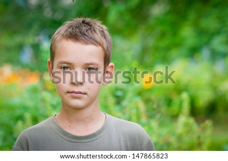 Portrait of Cute Little Boy looking at camera - stock photo