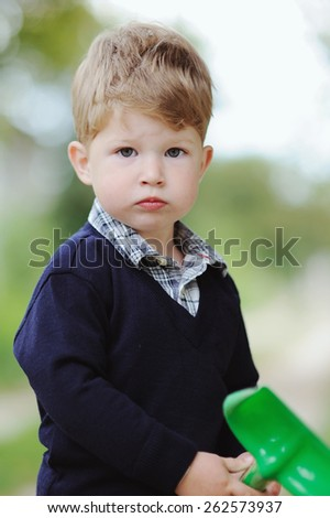 Portrait of cute little boy outdoor - stock photo