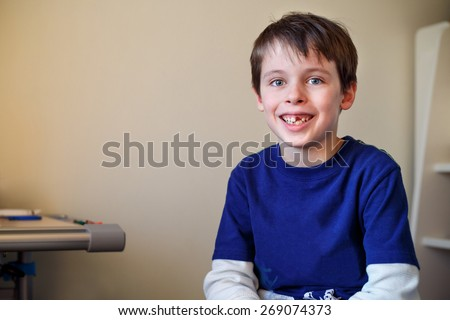 Portrait of cute little boy who lost his milk tooth - stock photo