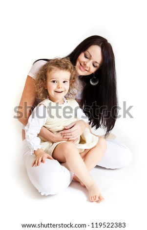 Portrait of cute little girl and her young mother - stock photo