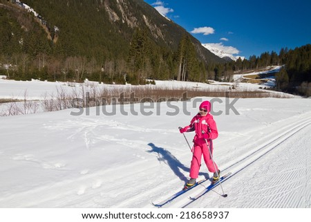 Portrait of cute little girl cross-country skiing - stock photo
