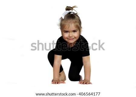 Portrait of cute little girl in sportswear on starting position isolated on white background, healthy lifestyle concept - stock photo