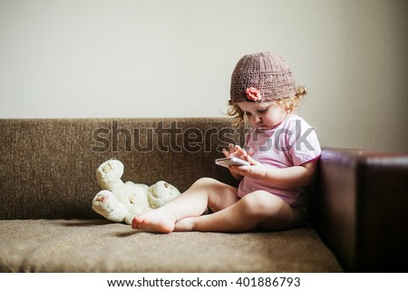 Portrait of cute little girl with the phone - stock photo