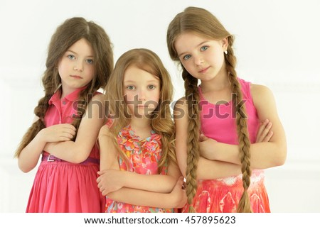 portrait of cute little girls posing - stock photo
