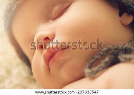 Portrait of cute newborn baby in a hat - stock photo