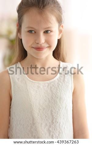 Portrait of cute small girl - stock photo