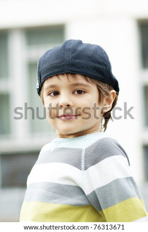 Portrait of cute smiling little boy, outdoor shot - stock photo