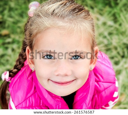 Portrait of cute smiling little girl outdoor - stock photo