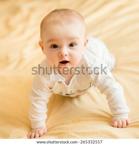 Portrait of  cute smiling newborn baby - stock photo