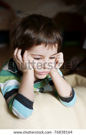 Portrait of cute upset sad lonely little boy - stock photo