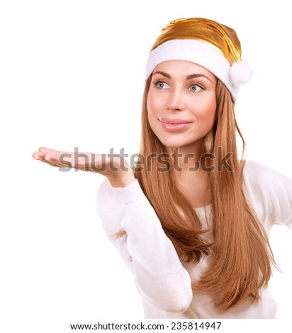 Portrait of cute woman wearing golden Santa hat isolated on white background, celebrating Christmas time holidays, costume party concept  - stock photo