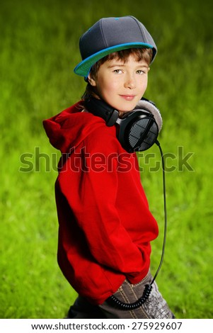 Portrait of cute7 years old boy outdoor. Summer day.  - stock photo