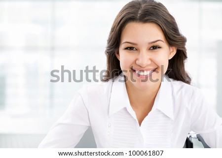 Portrait of cute young business woman smiling - stock photo