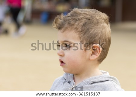 Portrait of cute young Caucasian little boy with blond hair - stock photo