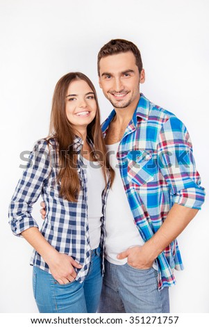 Portrait of cute young couple in checked shirts - stock photo
