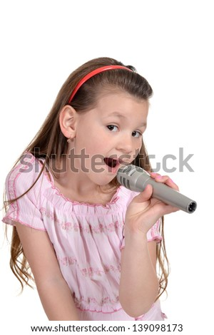 portrait of cute young girl singing on a white background - stock photo
