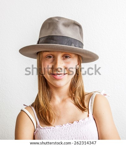 portrait of cute young teenage girl with hat - stock photo