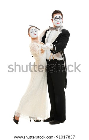 portrait of dancing couple of mimes. isolated on white background - stock photo