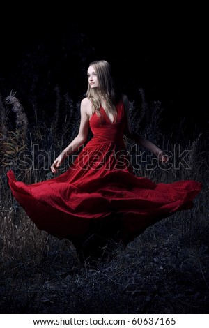 Portrait of dancing woman at forest - stock photo