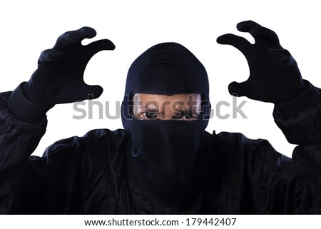 Portrait of dangerous bandit isolated on white background - stock photo